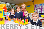 Teacher Fiona Cooke with junior infants Ruben Murphy, Conor McCarthy, Sophie McKenna and Julia Roche on their first day at school at Flemby NS