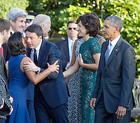 Prime Minister Matteo Renzi of Italy hugs United States National Security Advisor Susan Rice as US Vice President Joe Biden greets Mrs. Agnese Landini prior to the arrival ceremony at the start of an Official Arrival Ceremony on the South Lawn of the the White House in Washington, DC on Tuesday, October 18, 2016. US President Barack Obama looks on from right. <br /> Credit: Ron Sachs / CNP /MediaPunch