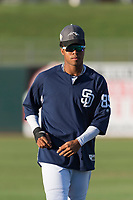 AFL West outfielder Buddy Reed (85), of the Peoria Javelinas and San Diego Padres organization, warms up in the outfield before the Arizona Fall League Fall Stars game at Surprise Stadium on November 3, 2018 in Surprise, Arizona. The AFL West defeated the AFL East 7-6 . (Zachary Lucy/Four Seam Images)