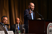 New York, NY - April 5, 2019: U.S. Representative Hakeem Jeffries speaks during the National Action Network's Annual Convention hosted by the Rev. Al Sharpton at the Times Square Sheraton Hotel in New York City, April 5, 2019, as Jesse Jackson and Sen. Cory Booker look on.  (Photo by Don Baxter/Media Images International)