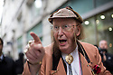 Day two: Industrial Tribunal London John McCririck outside the hearing where he will  contest his case against Channel 4 for age discrimination.<br /> <br /> Racing pundit John McCririck's employment tribunal over alleged age discrimination is to begin.<br /> <br /> The 73-year-old is taking former employer Channel 4 and TV production company IMG Media Limited to a tribunal, alleging his sacking last year was motivated by age discrimination.<br /> <br /> The case, at the Central London Employment Tribunal, is expected to last up to seven days. McCririck was dropped when the station unveiled a new presenting team headed by Clare Balding.<br /> <br /> <br /> <br /> <br /> Pic by Gavin Rodgers/Pixel 8000 Ltd 1.10.13