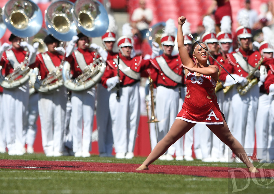 NWA Democrat-Gazette/J.T. WAMPLER Savannah Miller, University of Arkansas twirler, performs Saturday Sept. 1, 2018 during the Razorback football game against Eastern Illinois. Miller earned the silver medal at the 34th World Baton and Twirling Championships.