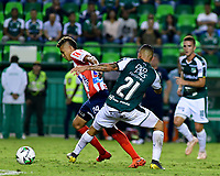 PALMIRA - COLOMBIA, 17-04-2019: Carlos Mario Rodriguez del Cali disputa el balón con Victor Cantillo de Junior durante partido por la fecha 16 de la Liga Águila I 2019 entre Deportivo Cali y Atlético Junior jugado en el estadio Deportivo Cali de la ciudad de Palmira. / Carlos Mario Rodriguez of Cali vies for the ball with Victor Cantillo of Junior during match for the date 16 as part Aguila League I 2019 between Deportivo Cali and Atletico Junior played at Deportivo Cali stadium in Palmira city.  Photo: VizzorImage / Nelson Rios / Cont