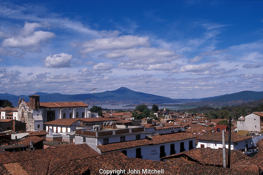 Red-tiled roofs of the Spanish colonial town of Patzcuaro with Lake Patzcuaro in the background, Michoacan, Mexico