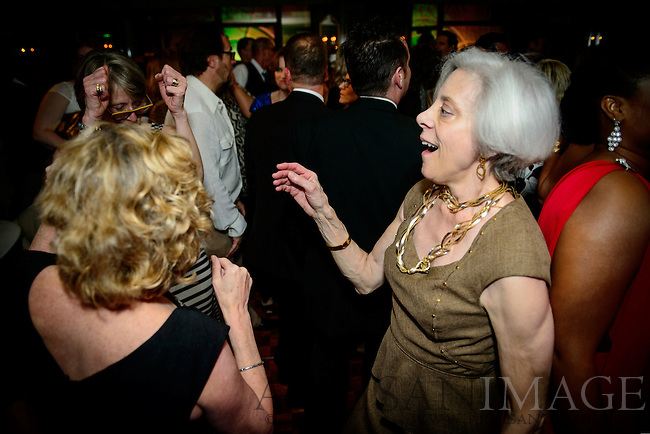 17th Annual Guilford Green Foundation Green Party at the O.Henry Hotel on Saturday, March 22, 2014. Supporters of Guilford Green celebrated a successful fundraiser with a 1970's style disco green party. (Photo/Artisan Image, Inc.)