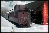 Caboose #0503 and other railroad work cars in Chama yard in snow.  D&amp;RGW #484 K-36 is next to Chama engine house.<br /> D&amp;RGW  Chama, NM