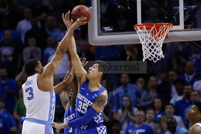 Kentucky Wildcats forward Derek Willis blocks a shot by North Carolina Tar Heels forward Kennedy Meeks during the 2017 NCAA Men's Basketball Tournament South Regional Elite 8 at FedExForum in Memphis, TN on Friday March 24, 2017. Photo by Michael Reaves | Staff