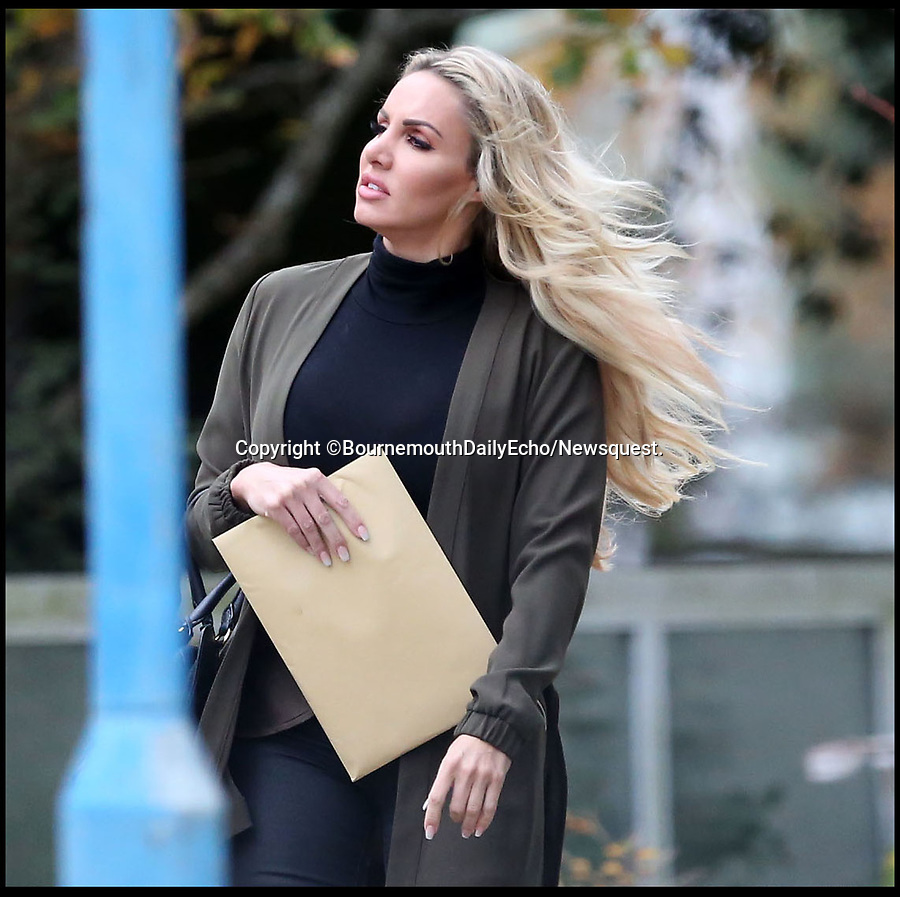 BNPS.co.uk (01202 558833)<br /> Pic: BournemouthEcho/BNPS<br /> <br /> Babestation' presenter Danielle Harwood arrives at Poole Magistrates Court.<br /> <br /> A British glamour model has been fined after being caught on her mobile phone at the wheel of her sports car.<br /> <br /> Dannii Harwood, who has more than 230,000 Twitter and 140,000 Instagram followers, was pulled over after an officer spotted her handling her mobile phone and looking at the screen while driving her Maserati in slow-moving traffic.<br /> <br /> The 35 year-old Babestation star protested her innocence, insisting she was stationary at the time and was not using the device, but just plugging it in.<br /> <br /> She said the officer who pulled her over made her 'feel uncomfortable' by posing questions about where she worked.