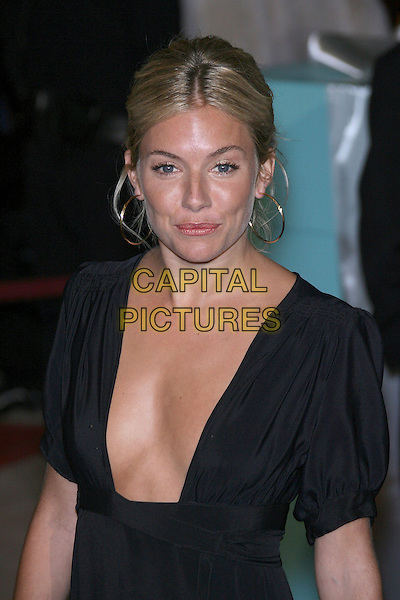 SIENNA MILLER.18th Annual Palm Springs International Film Festival Hosts Star-Studded Awards Gala held at the Palm Springs Convention Center, Palm Springs, California, USA,.6 January 2007..half length black dress plunging necklline low cut gold hoop earrings.CAP/ADM/ZL.©Zach Lipp/Admedia/Capital Pictures