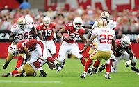 Sept. 13, 2009; Glendale, AZ, USA; Arizona Cardinals running back (26) Beanie Wells runs the ball in the second half against the San Francisco 49ers at University of Phoenix Stadium. San Francisco defeated Arizona 20-16. Mandatory Credit: Mark J. Rebilas-