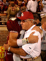 TALLAHASSEE, FL. 9/13/03-FSU QB Chris Rix, left, hugs Coach Bobby Bowden after the Seminoles beat Georgia Tech 14-13 Saturday at Doak Campbell Stadium in Tallahassee. COLIN HACKLEY PHOTO
