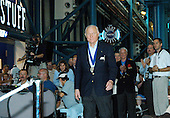 Before the induction ceremony of five space program heroes into the U.S. Astronaut Hall of Fame at the Kennedy Space Center in Florida on May 1, 2004, former astronaut John Glenn Jr. is greeted with applause as he is introduced as a previous inductee. One of America's original Mercury Seven astronauts, in 1962 he became the first American to orbit the Earth. Twenty-six years later, at age 77, he spent nine days in space aboard Space Shuttle Discovery. The ceremony was held at the Apollo/Saturn V Center at KSC. .Credit: NASA via CNP