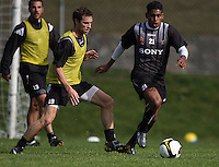 Roy Krishna gets past Andy Barron during the Wellington Phoenix A-League football training session Training Session at Newtown Park, Wellington, New Zealand on Monday, 4 May 2009. Photo: Dave Lintott / lintottphoto.co.nz