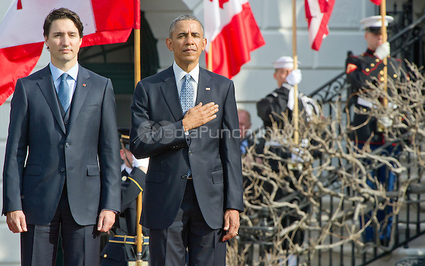 United States President Barack Obama, right, and Prime Minister Justin Trudeau of Canada, left, listen to the National Anthems during an Arrival Ceremony on the South Lawn of the White House in Washington, DC on Thursday, March 10, 2016. <br /> Credit: Ron Sachs / CNP/MediaPunch