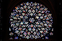 Rose window of the Upper chapel of La Sainte-Chapelle (The Holy Chapel), 1248, Paris, France. The gothic 16th century rose window shows the Apocalypse around an enthroned Christ in the central oculus. La Sainte-Chapelle was commissioned by King Louis IX of France to house his collection of Passion Relics, including the Crown of Thorns, and is considered among the highest achievements of the Rayonnant period of Gothic architecture. Picture by Manuel Cohen