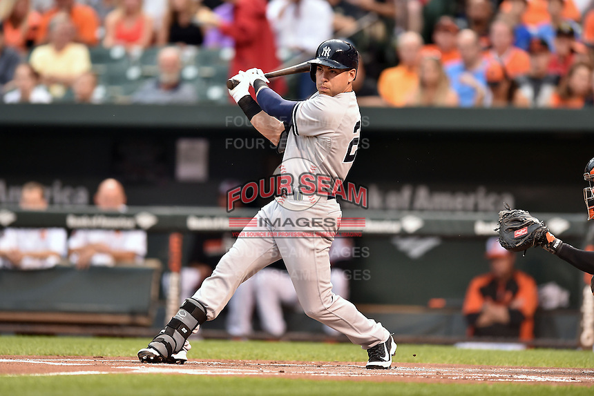 New York Yankees center fielder Jacoby Ellsbury #22  swings at a pitch during a game against the Baltimore Orioles at Oriole Park at Camden Yards August 11, 2014 in Baltimore, Maryland. The Orioles defeated the Yankees 11-3. (Tony Farlow/Four Seam Images)