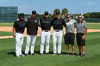 GCL Marlins coaching staff (L-R) manager Robert Rodriguez, pitching coach Jason Erickson, hitting coach Jesus Merchan, coach Jeff Hendrix, strength coach Kyle Morris, Athletic Trainer Sandy Krum after a Gulf Coast League game against the GCL Astros on August 8, 2019 at the Roger Dean Chevrolet Stadium Complex in Jupiter, Florida.  GCL Marlins defeated GCL Astros 5-4.  (Mike Janes/Four Seam Images)