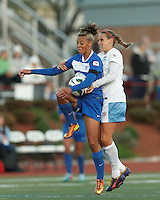 Boston Breakers forward Lianne Sanderson (10) attempts to control the ball as Chicago Red Stars midfielder Leslie Osborne (12) closely pressures. In a National Women's Soccer League Elite (NWSL) match, the Boston Breakers (blue) defeated Chicago Red Stars (white), 4-1, at Dilboy Stadium on May 4, 2013.