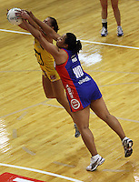 Ngarama Milner-Olsen and Finau Pulu compete for the ball during the ANZ Netball Championship match between the Central Pulse and Northern Mystics, TSB Bank Arena, Wellington, New Zealand on Monday, 4 May 2009. Photo: Dave Lintott / lintottphoto.co.nz