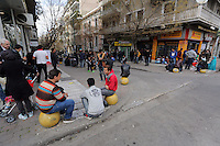 Pictured: Migrants in Heyden Street, Victoria Square. Tuesday 08 March 2016<br /> Re: Migrants at Victoria Square, in central Athens, Greece.
