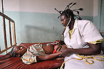 Nurse Augustine Elando cares for 16-year old Matildhe Anekumba as she prepares to give birth in the United Methodist Hospital in the village of Wembo Nyama, DR Congo.
