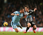Aleksander Kolarov of Manchester City brought down by Daryl Janmaat of Newcastle United - Barclays Premier League - Manchester City vs Newcastle Utd - Etihad Stadium - Manchester - England - 21st February 2015 - Picture Simon Bellis/Sportimage