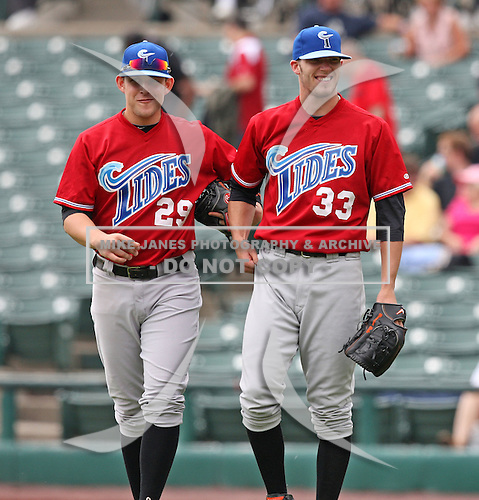 Norfolk Tides Starting Pitcher Brandon Erbe (33) jokes with Brandon Snyder (29) during a game vs. the Rochester Red Wings at Frontier Field in Rochester, New York;  June 3, 2010.   Rochester defeated Norfolk by the score of 9-0.  Photo By Mike Janes/Four Seam Images