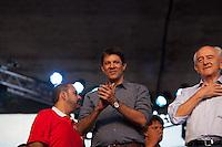 SÃO PAULO, SP, 01 DE MAIO DE 2013 - COMEMORAÇÕES DIA DO TRABALHADOR - CUT -  O Prefeito da Cidade, Fernando Haddad(c) e o Ministro do Trabalho, Manoel Dias comparecem ao evento da Central Única dos Trabalhadores - CUT, representando a Presidente Dilma Roussef, o evento reuniu uma grande multidão de pessoas no Vale do Anahngabaú, zona central da cidade, nesta quarta-feira (1), para as comemorações do Dia do Trabalhador. O evento contou com shows de cantores da MPB e políticos ligado ao PT.  (FOTO RICARDO LOU/BRAZIL PHOTO PRESS)