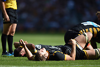 Joe Launchbury of Wasps lies on the ground in exhaustion late in the game. Aviva Premiership Final, between Wasps and Exeter Chiefs on May 27, 2017 at Twickenham Stadium in London, England. Photo by: Patrick Khachfe / JMP