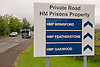 Road sign to the entrance of HMP Featherstone, HMP Brinsford and HMP Oakwood