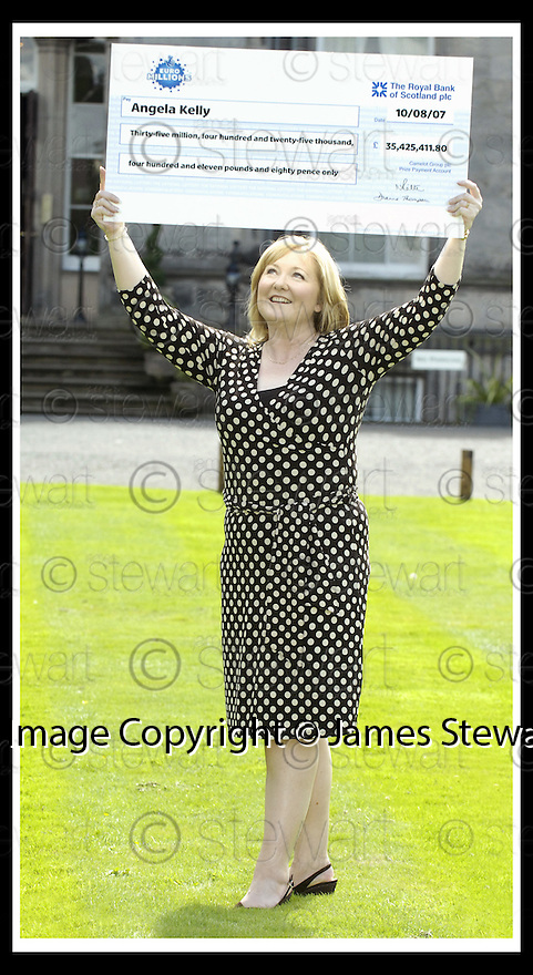 15/08/2007       Copyright Pic: James Stewart.File Name : sct_jspa13_lottery.ANGELA KELLY AT THE PRESS CONFERENCE WHERE SHE COLLECTED HER CHEQUE FOR £35,425,411.80 AFTER HER EUROMILLIONS LOTTERY WIN.....James Stewart Photo Agency 19 Carronlea Drive, Falkirk. FK2 8DN      Vat Reg No. 607 6932 25.Office     : +44 (0)1324 570906     .Mobile   : +44 (0)7721 416997.Fax         : +44 (0)1324 570906.E-mail  :  jim@jspa.co.uk.If you require further information then contact Jim Stewart on any of the numbers above........