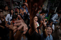 Supporters try to touch a hand of Thailand's Prime Minister Abhisit Vejjajiva as he campaigns for his ruling Democrat Party in Bangkok June 30, 2011. Thailand holds a general election on July 3 that might be a step on the road to stability after five years of political turbulence. But it could just as easily prolong the crisis, especially if there is no clear-cut winner.    REUTERS/Damir Sagolj (THAILAND)