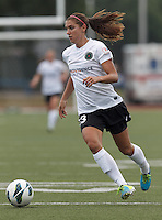 Portland Thorns FC forward Alex Morgan (13) on the attack.  In a National Women's Soccer League (NWSL) match, Portland Thorns FC (white/black) defeated Boston Breakers (blue), 2-1, at Dilboy Stadium on July 21, 2013.