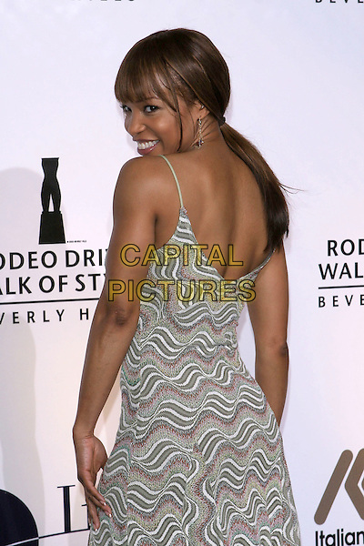 ELISE NEAL.2005 Rodeo Drive Walk Of Style Honoring Herb Ritts and Mario Testino held on Rodeo Drive. Beverly Hills, CA.March 20th, 2005.Photo Credit: Jacqui Wong/AdMedia.half length summery dress looking over shoulder grey gray stripes pattern.www.capitalpictures.com.sales@capitalpictures.com.© Capital Pictures.