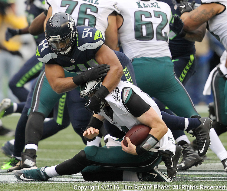 Seattle Seahawks middle linebacker Bobby Wagner #54 sacks Philadelphia Eagles Quarterback Carson Wentz #11<br /> at CenturyLink Field in Seattle, Washington on November 20, 2016.  Seahawks beat the Eagles 26-15.  &copy;2016. Jim Bryant Photo. All Rights Reserved.