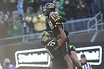 Nov 21, 2015; Eugene, OR, USA; Oregon Ducks offensive lineman Tyrell Crosby (73) hoists Ducks' wide receiver Dwayne Stanford (88) after making a touchdown reception against the USC Trojans at Autzen Stadium. <br /> Photo by Jaime Valdez