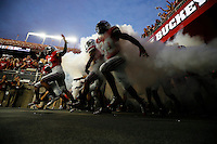 The Ohio State Buckeyes take the field before the college football game between the Ohio State Buckeyes and the Virginia Tech Hokies at Ohio Stadium in Columbus, Saturday afternoon, September 6, 2014. (The Columbus Dispatch / Eamon Queeney)