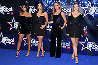 LONDON, UK. March 07, 2019: Little Mix arriving for the Global Awards 2019 at the Hammersmith Apollo, London.<br /> Picture: Steve Vas/Featureflash