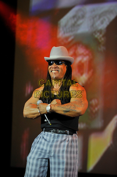 Melle Mel.performing at 'Something For Nothing: The Art of Rap'  European premiere, Hammersmith Apollo, London, England. 19th July 2012..show music live on stage concert gig.half length  black vest  microphone  necklace hat sunglasses grey gray tartan paid trousers .CAP/MAR.© Martin Harris/Capital Pictures.