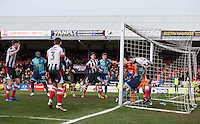 Will De Havilland of Wycombe Wanderers battles Shaun Pearson & Goalkeeper James McKeown of Grimsby Town on the goal line with the ball managed to be kept out during the Sky Bet League 2 match between Grimsby Town and Wycombe Wanderers at Blundell Park, Cleethorpes, England on 4 March 2017. Photo by Andy Rowland / PRiME Media Images.