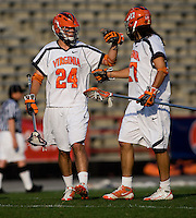 Ryan Nizolek (24) and Ken Clausen (27) of Virginia celebrate a goal during the ACC men's lacrosse tournament semifinals in College Park, MD.  Virginia defeated Duke, 16-12.