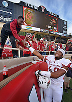 STAFF PHOTO BEN GOFF  @NWABenGoff -- 09/13/14 Arkansas defensive end Deatrich Wise, Jr. greets fans following the Razorbacks' defeat of Texas Tech in Jones AT&T Stadium in Lubbock, Texas on Saturday September 13, 2014.