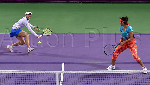 23.02.2016. Doha, Qatar. Qatar Total Open championships.   Martina Hingis (L) of Switzerland and Sania Mirza of India compete during their womens doubles second round match against Zheng Saisai and Xu Yifan of China at the WTA Tennis Damen Qatar Open 2016 in Doha, Qatar, Feb. 23, 2016. Martina Hingis and Sania Mirza won 2-1.