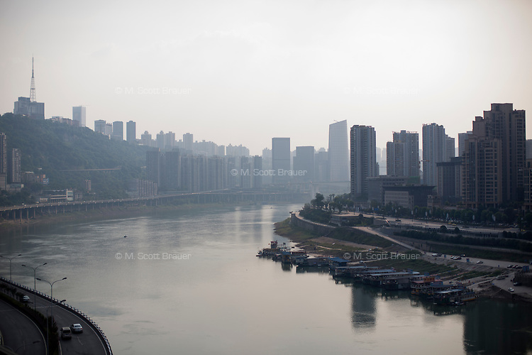 A view of buildings, bridges, interchanges, and the Jialing River from the Niujiaotuo subway platform in Chongqing, China.