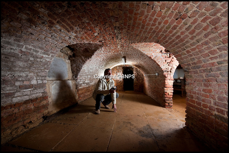 BNPS.co.uk (01202 558833)<br /> Pic: PhilYeomans/BNPS<br /> <br /> Historian Richard Landy in the recently discovered 'cheese' cellars under a pub on Stilton's high street.<br /> <br /> Cheesemakers from the village which gave world-famous Stilton its name have renewed hope of overturning a law which bans them from naming their product 'Stilton'.<br /> <br /> Villagers from Stilton in Cambridgeshire were cheesed off when in 1996 it was ruled that the  product could only be made in Leicestershire, Nottinghamshire and Derbyshire.<br /> <br /> After years of kicking up a stink over the &quot;farcical&quot; decision an application was made to Defra to get the protected designation of origin (PDO) extended to Stilton village.<br /> <br /> It was promptly dismissed despite evidence purporting to show that cheese was made in the village as far back as Roman times.<br /> <br /> But now campaigners are mounting another attempt at convincing the grand fromages in Whitehall that their cheese deserves recognition under the Stilton name.<br /> <br /> They are taking their fight to Defra minister George Eustice in the hope that their efforts have not all been in vein.<br /> <br /> Local historian Richard Landy, who for five years has spearheaded the campaign, says new evidence proves it was produced in Stilton village.<br /> <br /> Mr Landy dug up a Roman cheese mould buried in a field in the village in 2006 and has since discovered network of underground cellars thought to have been used to mature cheese.<br /> <br /> A cheese recipe was also found in letter printed in a 1726 edition of General Treatise of Husbandry and Gardening adding further weight to his plight.
