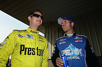 Sept. 30, 2012; Madison, IL, USA: NHRA top fuel dragster driver T.J. Zizzo (right) with Spencer Massey during the Midwest Nationals at Gateway Motorsports Park. Mandatory Credit: Mark J. Rebilas-