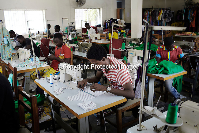 LAGOS, NIGERIA - MAY 28: Factory workers make garments for a designer in a factory on May 28, 2013, in Lagos, Nigeria. There's a growing fashion market in Nigeria and Africa. Many clothes are made in local factories. (Photo by Per-Anders Pettersson)