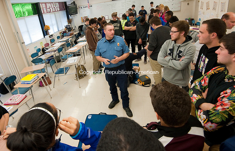 TORRINGTON, CT--- -120915JS03--Lt. Robert Shopey III, of the Torrington Fire Department, gives instructions to students during a CPR class Wednesday at Torrington High School. The students were taught proper breathing and compression technique on someone in need of CPR as well as how to properly use an Automated External Defibrillators (AED) during the class. <br />   Jim Shannon Republican-American