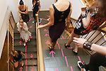 Models make their way down a staircase during New York Fashion week.