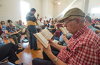 NWA Democrat-Gazette/BEN GOFF @NWABENGOFF<br /> Bill Caldwell, center, leads the Northwest Arkansas Sacred Harp Singers in a traditional song Saturday, June 30, 2018, during a grand opening for the renovated Shiloh Meeting Hall in downtown Springdale. Constructed in 1871, the building served as a home to multiple church congregations, fraternal organizations and other community functions over it's lifetime. In 2005 the Independent Order of Odd Fellows donated the building to the Shiloh Museum of Ozark History for it's restoration and preservation. The restored first floor will again be used by community groups and the museum for functions, and will be available to rent for events. The second floor, expected to open in 2020, will be an exhibit hall telling the story of the building and the history of the organizations that have called it home.